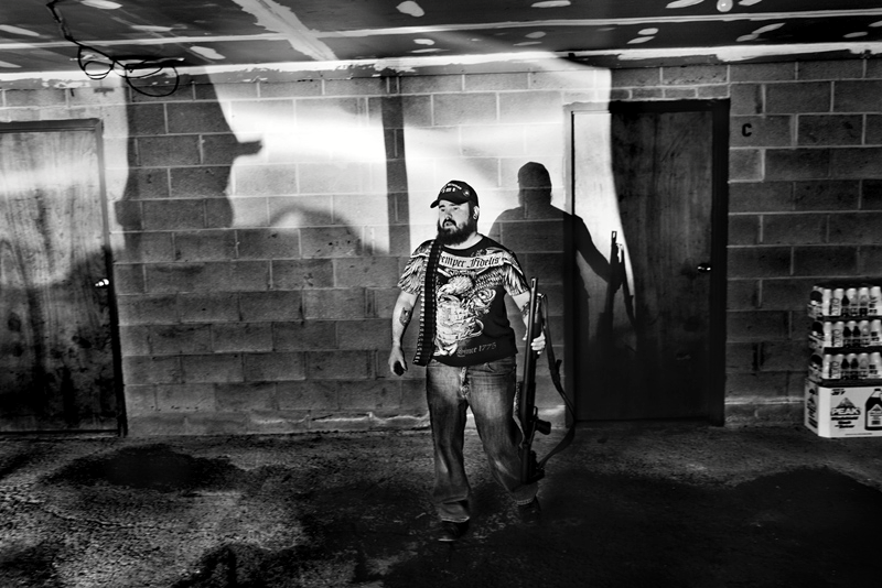 """""""A former US Marine corp sniper with his weapon. Rochester, NY. USA 2012""""- Paolo Pellegrin"""